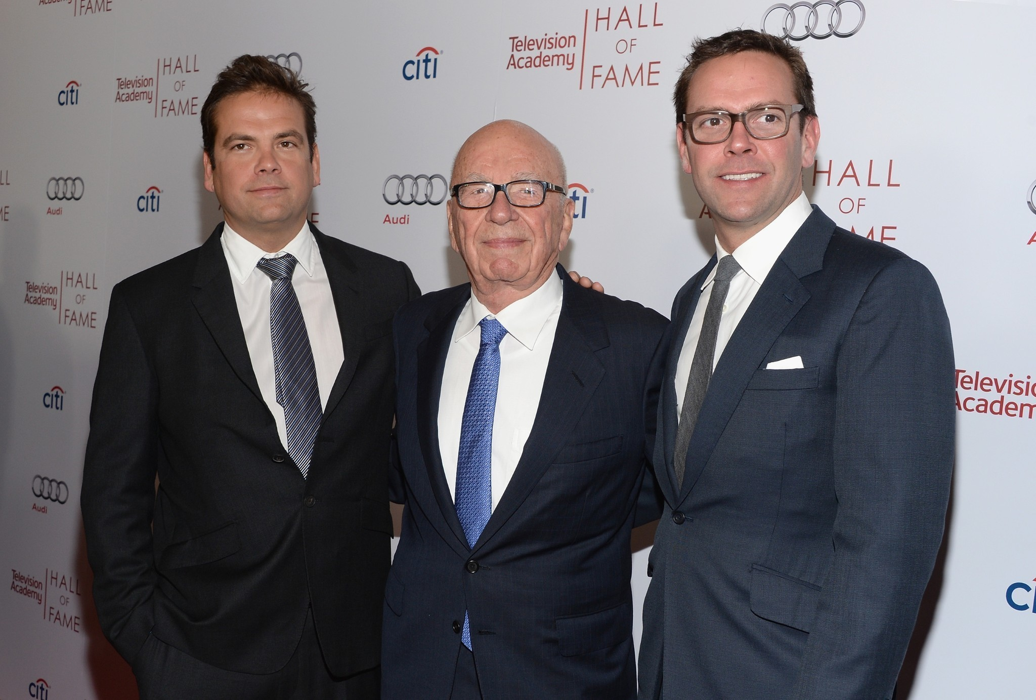 Back in the Fox fold: Lachlan Murdoch, left, rejoins father Rupert and brother James.